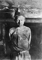 0107787 © Granger - Historical Picture ArchiveHINE: CHILD LABOR, 1908.   A 'trapper boy' more than a mile inside at Turkey Knob Mine, Macdonald, West Virginia. Photograph by Lewis Hine, October 1908.