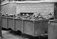 0107908 © Granger - Historical Picture ArchiveWEST VIRGINIA: COAL MINE.   'The next trip.' Coal miners sitting in a mining car, ready to go into the mine shaft at Maidsville, West Virginia. Photograph by Marion Post Wolcott, September 1938.
