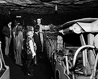 0172057 © Granger - Historical Picture ArchiveCOAL MINE: FIELD TRIP.   An educator teaching a group of schoolchildren about a machine used in coal mining. Photograph, c1974.