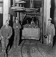 0259164 © Granger - Historical Picture ArchivePENNSYLVANIA: COAL MINERS.   Miners and a car full of coal in an coal mine in Scranton, Pennsylvania. Photograph, c1905.
