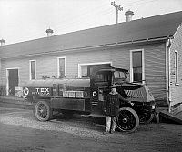 0118782 © Granger - Historical Picture ArchiveOIL DELIVERY TRUCK, c1920.   Texaco oil delivery truck and driver. Photograph, c1920.