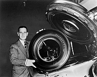 0097781 © Granger - Historical Picture ArchiveHARVEY S. FIRESTONE, JR. (1898-1973).   American businessman. Firestone displaying a 'national defense tire,' one of 150 synthetic tires produced by the Firestone Tire and Rubber Company. Photographed at the New York World's Fair, 1939.