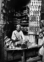 0130607 © Granger - Historical Picture ArchiveDAMASCUS: SLIPPER MAKER.   An inlaid slipper maker in his shop in Damascus, Syria. Photograph, c1910.