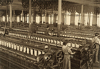 0131746 © Granger - Historical Picture ArchiveHINE: TEXTILE MILL, 1912.   The spinning room at the Flint Cotton Mill in Fall River, Massachusetts. Photograph by Lewis Hine, January 1912.