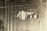 0132812 © Granger - Historical Picture ArchiveTEXTILE MILL, 1908.   A warper at his machine in a cotton mill in Newton, North Carolina. Photograph by Lewis Hine, December 1908.