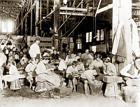 0003312 © Granger - Historical Picture ArchiveCHILD LABOR, 1912.   Children working in a vegetable cannery in Baltimore, Maryland. Photograph by Lewis W. Hine, 1912.