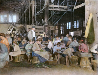 0008090 © Granger - Historical Picture ArchiveCHILD LABOR, 1912.   Children working in a vegetable cannery in Baltimore, Maryland.  Oil over a photograph. Original photograph by Lewis W. Hine, 1912.