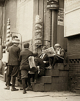 0107264 © Granger - Historical Picture ArchiveDELAWARE: NEWSBOYS, 1910.   A group of newsboys sitting on a stoop with newspapers at 4th and Market Streets, Wilmington, Delware. Photograph by Lewis Hine, May 1910.