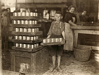 0107509 © Granger - Historical Picture ArchiveHINE: CHILD LABOR, 1909.   One of the young workers at the J.S. Farrand Packing Company in Baltimore, Maryland. Photograph by Lewis Hine, July 1909.