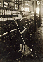 0131513 © Granger - Historical Picture ArchiveHINE: CHILD LABOR, 1916.   A young cleaner and sweeper at the Spinning Department of American Linen Co. textile mill in Fall River, Massachusetts. Photograph by Lewis Hine, June 1916.
