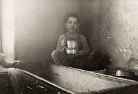 0167336 © Granger - Historical Picture ArchiveHINE: CHILD LABOR, 1912.   A young textile mill worker eating his lunch in a doffing box in Fall River, Massachusetts. Photograph by Lewis Hine, January 1912.