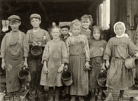 0167533 © Granger - Historical Picture ArchiveHINE: CHILD LABOR, 1911.   Nine of these children from 8 years old up go to school half a day. They shuck oysters for four hours before school and three hours after school and on Saturday from 4 A.M. to early afternoon at the Maggioni Canning Co. in Port Royal, South Carolina. Photograph by Lewis Hine, February 1911.