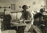 0324018 © Granger - Historical Picture ArchiveHINE: EMBOSSING SHOP, 1917.   A 15-year-old girl cutting dies in Harry C. Taylor's embossing shop, 61 Court Street in Boston, Massachusetts. Photograph by Lewis Wickes Hine, January 1917.