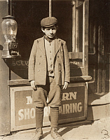 0324035 © Granger - Historical Picture ArchiveHINE: CHILD LABORER, 1910.   Jacob Futterman, a 16-year-old coconut shaver at Kibbe's Factory in Springfield, Massachusetts. Photograph by Lewis Wickes Hine, 1910.