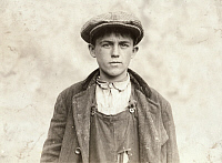 0324047 © Granger - Historical Picture ArchiveHINE: BOY, 1916.   17-year-old James Donovan, an Irish sweeper at the Fall River Iron Works in Fall River, Massachusetts. Photograph by Lewis Wickes Hine, 1916.