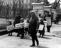 0118981 © Granger - Historical Picture ArchiveWAGE PROTEST, 1926.   A group of adults and children from Passaic, New Jersey, picket the White House following President Coolidge's refusal to listen to their concerns regarding wage cuts in the textile industry. Photographed on 15 April 1926.