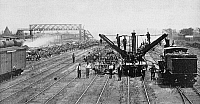 0000918 © Granger - Historical Picture ArchivePULLMAN STRIKE, 1894.   A wrecking-crew clearing a Chicago railway yard of burned freight cars. Photograph, American, 1894.