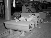 0326691 © Granger - Historical Picture ArchiveFLINT SIT DOWN STRIKE, 1937.   A striker sleeping on an assembly line of auto seats in the Fisher body plant #3 in Flint, Michigan, during the Flint Sit Down Strike. Photograph by Dick Sheldon, 1937.