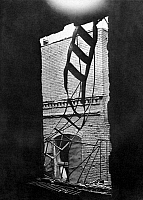 0045584 © Granger - Historical Picture ArchiveTRIANGLE FACTORY FIRE.   The only fire escape at the Triangle Shirtwaist Factory in New York City, hanging mangled from the heat and the weight of the escaping women in the aftermath of the fire that struck on 25 March 1911.