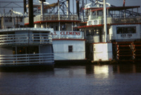 0162848 © Granger - Historical Picture ArchiveST. LOUIS: STEAMBOATS.   The paddle steamboats 'Samuel Clemens' and 'Huck Finn' docked along the Mississippi River in St. Louis, Missouri. Photographed c1974.