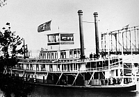 0165567 © Granger - Historical Picture ArchiveMISSISSIPPI STEAMBOAT, 1907.   The steamboat 'Mississippi' approaching Quincy, Illinois during an inspection trip down the Mississippi River by President Theodore Roosevelt (waving hat on upper deck), October 1907.