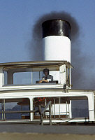 0167171 © Granger - Historical Picture ArchiveDANUBE: STEAMBOAT CAPTAIN.   The captain of a steamboat on the Danube River photographed while leaving Passau, Bavaria, Germany, c1974.