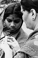 0125856 © Granger - Historical Picture ArchiveINDIA: BIRTH CONTROL, 1972.   A teacher explains a loop, an intra-uterine contraceptive device to a village mother, 1972.