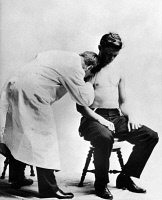0119856 © Granger - Historical Picture ArchiveDOCTOR AND PATIENT, c1915.   Dr. Sigard A. Knopf (1857-1940) listening to a patient's heart, c1915.