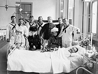 0268302 © Granger - Historical Picture ArchiveBROOKLYN: HOSPITAL, c1900.   Sailors and women visiting a patient at the Brooklyn Navy Yard Hospital in Brooklyn, New York. Photograph, c1900.