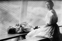 0325787 © Granger - Historical Picture ArchiveFLOATING HOSPITAL, c1910.   Two girls, possibly in the isolation ward, aboard the 'Helen C. Juilliard,' a floating hospital operated for the poor by the St. John's Guild in New York City. Photograph, c1910.