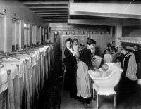 0325789 © Granger - Historical Picture ArchiveFLOATING HOSPITAL, c1910.   The bathroom on the 'Helen C. Juilliard,' a floating hospital operated for the poor by the St. John's Guild in New York City. Photograph, c1910.