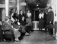 0323408 © Granger - Historical Picture ArchivePUBLIC HEALTH DISPENSARY.   Patients waiting in the segregated waiting room at a public health dispensary in Washington, D.C. Photograph, November 1920.