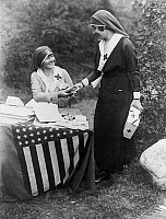 0162731 © Granger - Historical Picture ArchiveRED CROSS FUNDRAISER, 1917.   Actresses Frances Starr and Bijou Fernandez count money collected at the National Red Cross Pageant in Huntington, Long Island, 5 October 1917.
