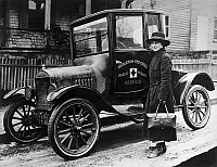 0176157 © Granger - Historical Picture ArchiveRED CROSS: NURSE & CAR, 1916.   A Red Cross nurse with a new Model T Ford, in Bridgeton, Massachusetts. Photograph, 1916.