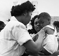 0125867 © Granger - Historical Picture ArchivePHILIPPINES: VACCINATION.   A nurse vaccinating a little boy during a nationwide health drive in the Philippines, 1953.