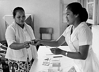 0125741 © Granger - Historical Picture ArchiveINDONESIA: BIRTH CONTROL.   A nurse at a family planning clinic in the village of Pegu Jangen hands an intra-uterine loop to a woman.