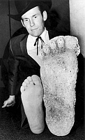 0002327 © Granger - Historical Picture Archive'BIGFOOT' FOOTPRINT, 1967.   Roger Patterson comparing his foot with a plaster cast of a footprint by the purported 'Bigfoot' or 'Sasquatch,' which Mr. Patterson said he sighted in a California forest in 1967.
