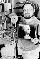 0059912 © Granger - Historical Picture ArchiveUFO: ALIEN PORTRAIT, 1978.   Stanton T. Friedman holding a photograph of a sculpture, claimed to be a portrait of a visitor from outer space, made from the recollections under hypnosis of a New Hampshire man who believed he was taken aboard a UFO in 1971. Photograph taken in 1978.