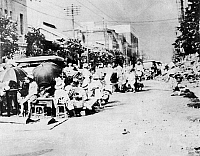 0006802 © Granger - Historical Picture ArchiveTOKYO EARTHQUAKE, 1923.   Survivors of the great Japanese earthquake of 1 September 1923 gathered in one of the main streets of Tokyo. Photograph.
