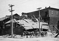 0092541 © Granger - Historical Picture ArchiveSAN FRANCISCO EARTHQUAKE.   Fifteenth and Folsom Streets, home of Abramson-Heunisch Glass Company, following the earthquake of 18 April 1906.