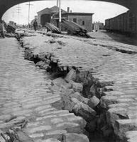 0119562 © Granger - Historical Picture ArchiveSAN FRANCISCO EARTHQUAKE.   A cracked cobblestone street by the waterfront, following the earthquake of 18 April 1906. Stereograph, 1906.