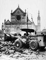 0123975 © Granger - Historical Picture ArchiveFLORENCE: FLOOD, 1966.   A bulldozer clearing mud and debris from a street in front of the Basilica of the Holy Cross in Florence, Italy, after the flood of the Arno River, 8 November 1966.