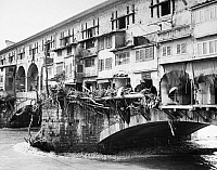 0124011 © Granger - Historical Picture ArchiveFLORENCE: FLOOD, 1966.   Damage to goldsmith shops on the Ponte Vecchio and debris marking the high water line of the flood of the Arno River. Photograph, 5 November 1966.