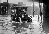 0130072 © Granger - Historical Picture ArchiveCLEVELAND: FLOOD, c1913.   A car driving down a flooded street in Cleveland, Ohio, c1913.