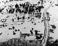 0163495 © Granger - Historical Picture ArchiveMISSISSIPPI FLOOD, 1927.   Aerial view of Arkansas City, Arkansas, during the Great Mississippi River Flood, 1 May 1927.