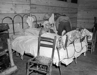 0324895 © Granger - Historical Picture ArchiveRED CROSS INFIRMARY, 1937.   A sick flood refugee in the Red Cross temporary infirmary at a flood refugee camp in Forrest City, Arkansas. Photograph by Walker Evans, February 1937.