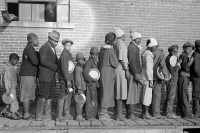 0324907 © Granger - Historical Picture ArchiveFLOOD REFUGEES, 1937.  People waiting in a food line at a flood refugee camp in Forrest City, Arkansas. Photograph by Edwin Locke, February 1937.