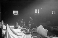 0324911 © Granger - Historical Picture ArchiveARKANSAS: REFUGEES, 1937.   A cotton compress being used by the Red Cross as a temporary infirmary in Forrest City, Arkansas, after the Ohio River flood. Photograph by Edwin Locke, February 1937.