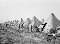 0325850 © Granger - Historical Picture ArchiveARKANSAS: REFUGEE CAMP.   Tents in the camp for black flood refugees in Forrest City, Arkansas. Photograph by Edwin Locke, March 1937.