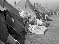 0325851 © Granger - Historical Picture ArchiveARKANSAS: REFUGEE CAMP.   Tents in the camp for black flood refugees in Forrest City, Arkansas. Photograph by Edwin Locke, March 1937.
